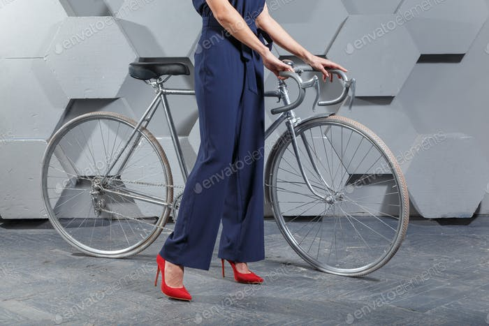 Fashionably dressed woman with bike
