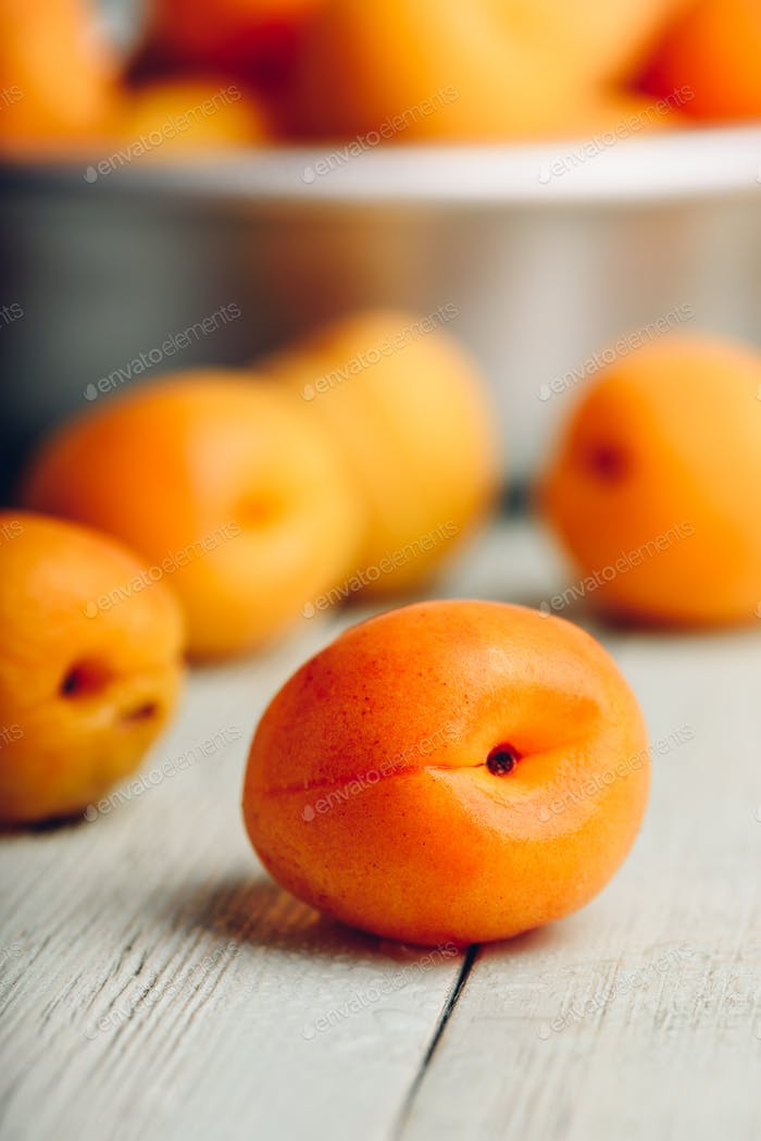 Mellow apricots over light wooden surface