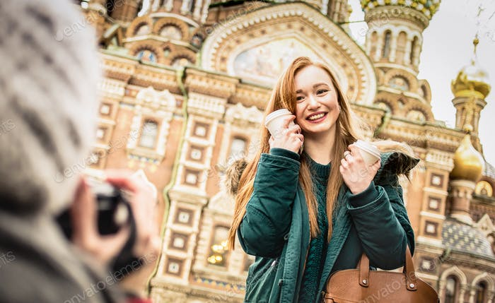 Happy girlfriends taking winter travel photo in Saint Petersburg