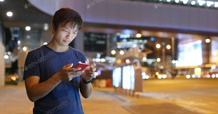 Man check on cellphone in the street