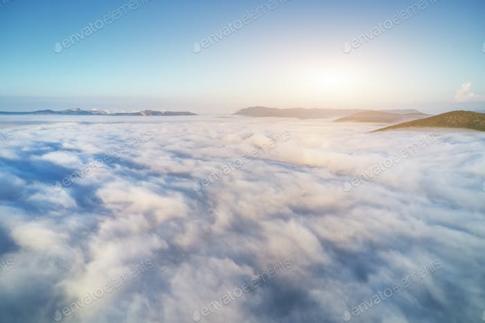 Aerial view white clouds in blue sky at morning.