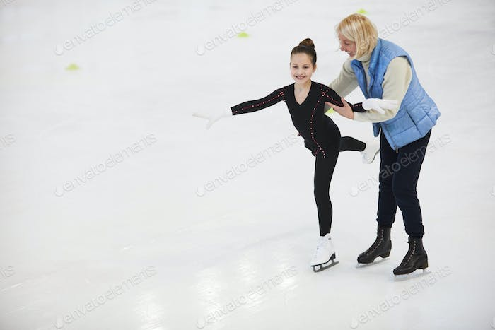 Coach Helping Girl Figure Skating