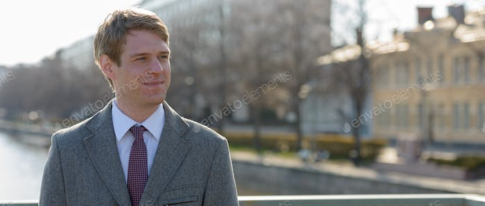 Handsome Scandinavian businessman with blond hair outdoors