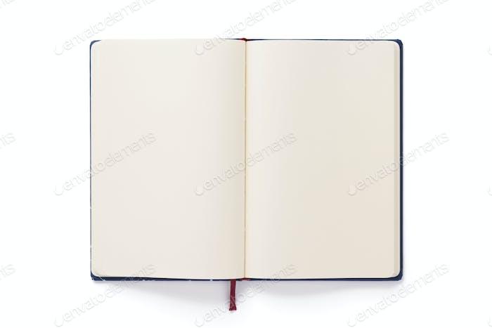 offenes Notizbuch oder Buch auf weißem Hintergrund