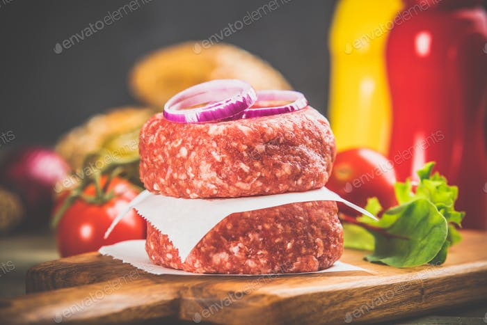 Homemade hamburgers on wooden table, close up