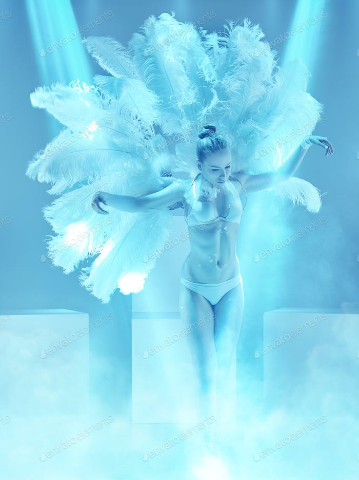 The studio shot of female modern dancer on blue background
