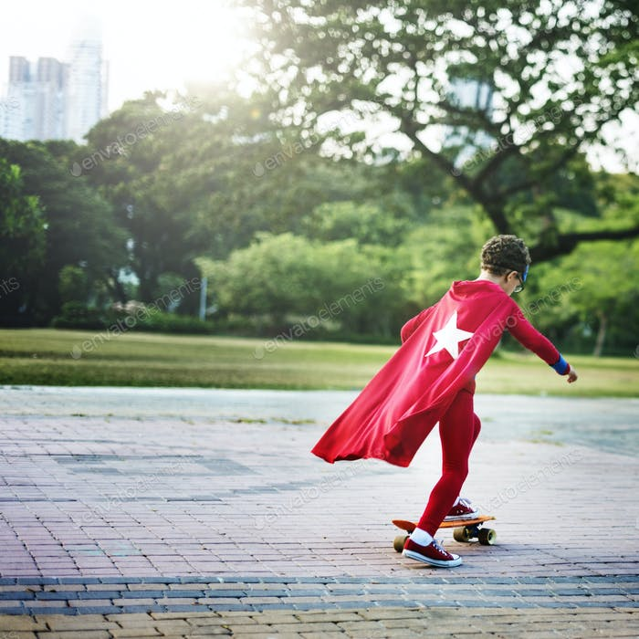 Kid Skateboard Superhero Youth Playful Concept