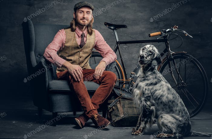 A man with Ireland setter dog.
