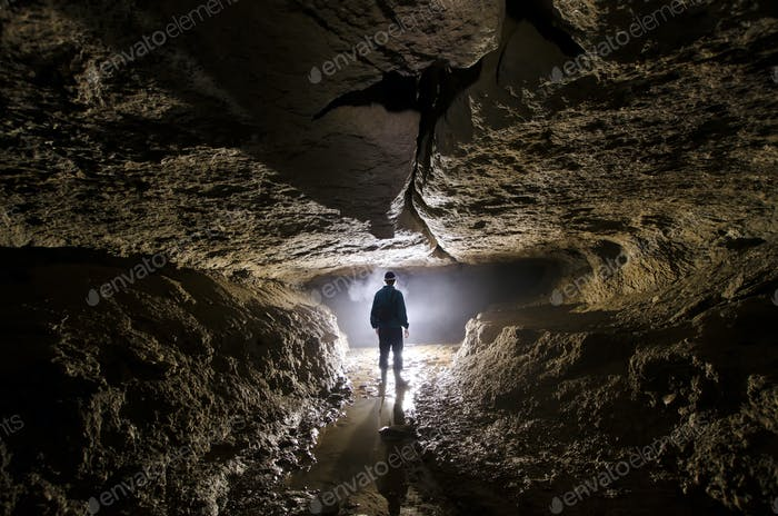 Man in cave with mysterious light