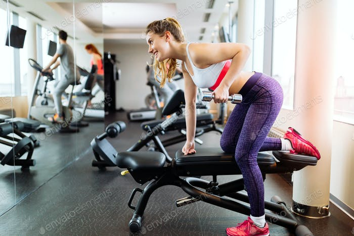 Young and fit people cardio workout in gym