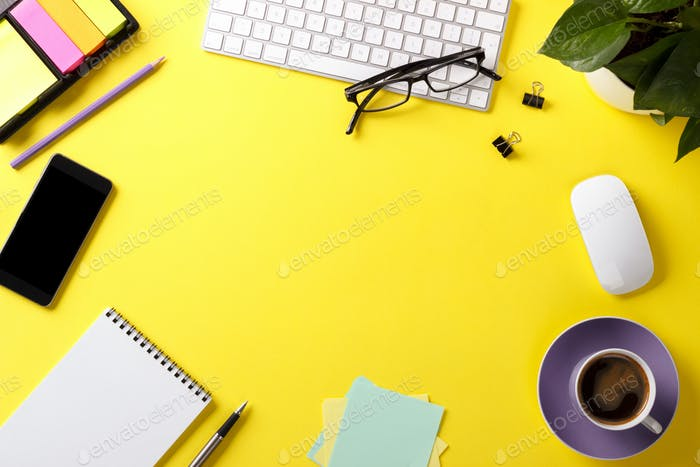 Yellow office desk with supplies