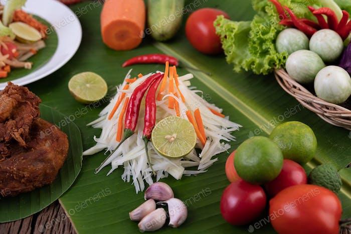 Som Tam Thai -Ingredients Papaya Salad Thai Food Style on wooden table background. Thai Food.