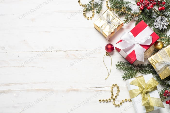Thumbnail for Red and Gold present box and decorations on white wooden backgro