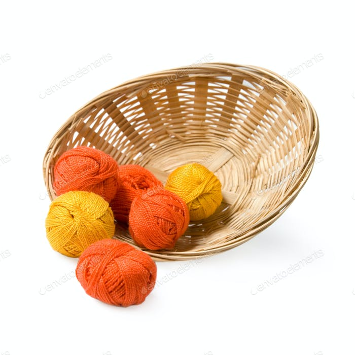 Woven basket with threads.