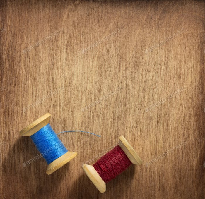 spool of thread on wood