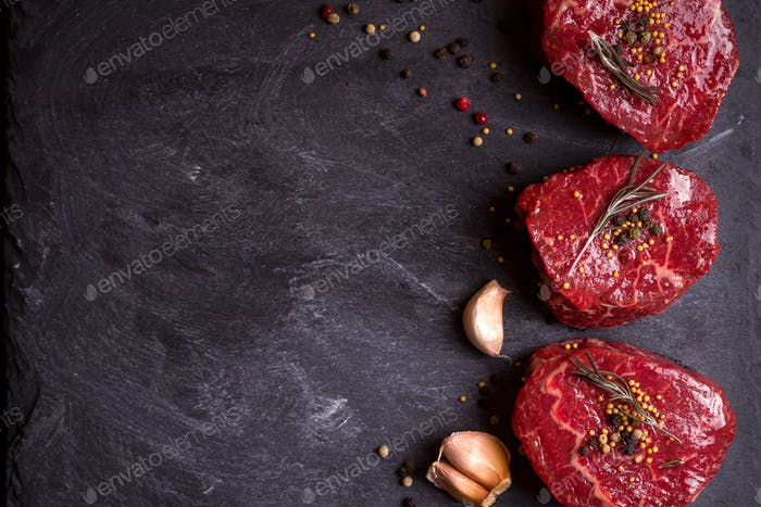 Raw filet mignon steaks with spices