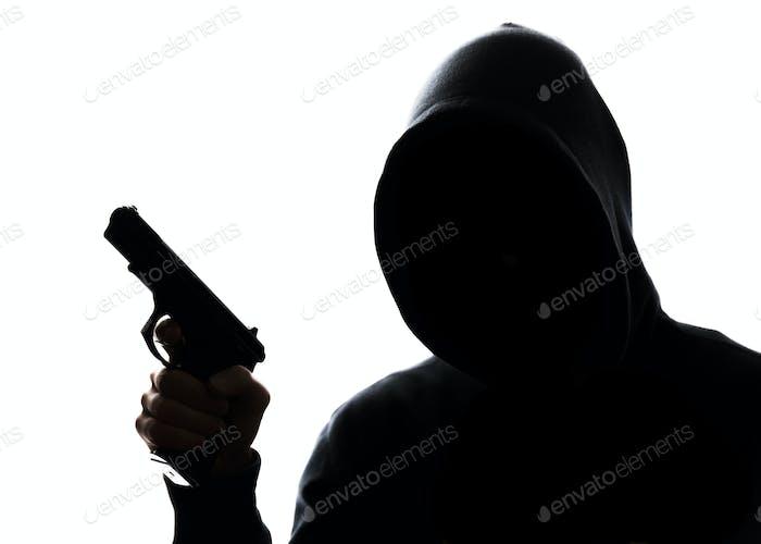Unrecognizable man with handgun