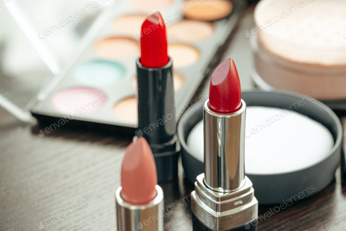 Pink and red lipsticks on vanity table
