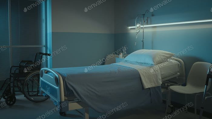 Clean hospital room interior at night
