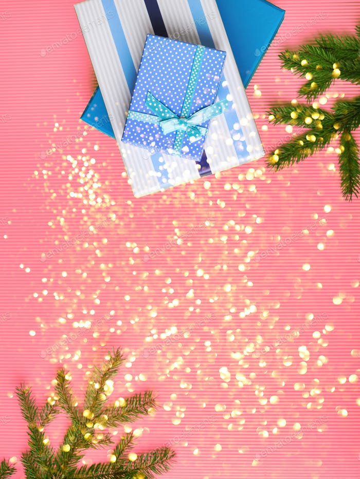 Gift boxes stack on pink background with glitter