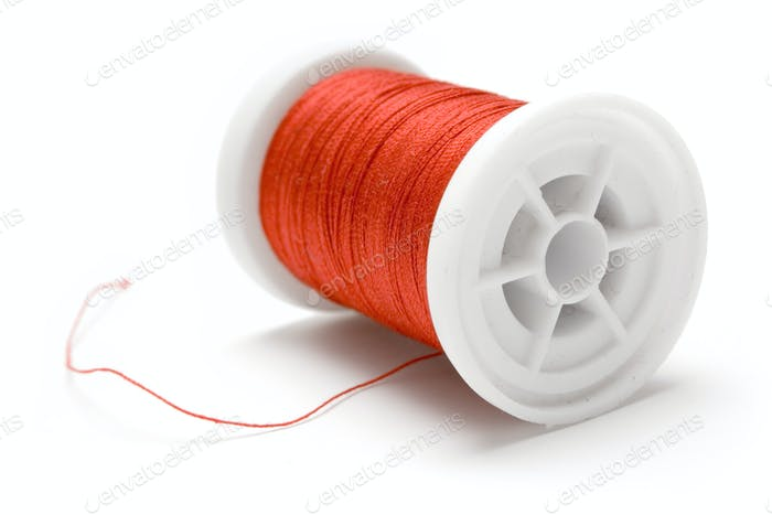 Spool of Red Thread Isolated on a White Background