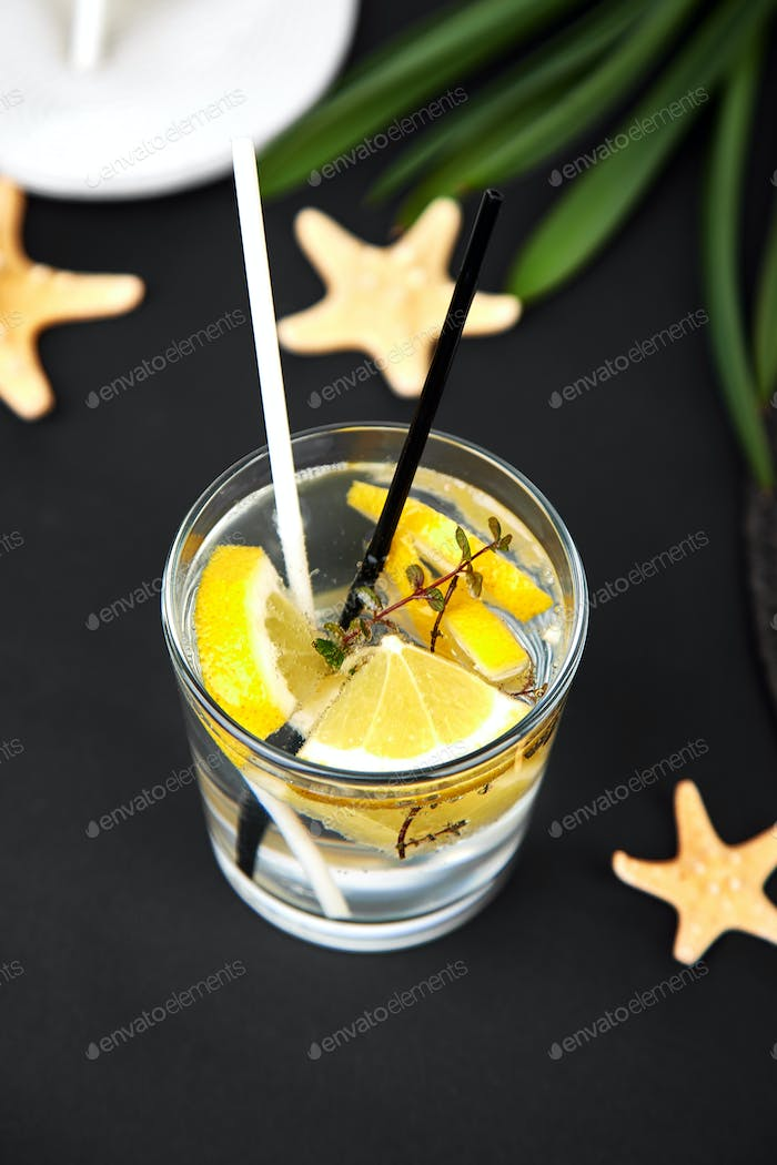 Holidays and drink concept. Cold cocktail, lemonade with lemon