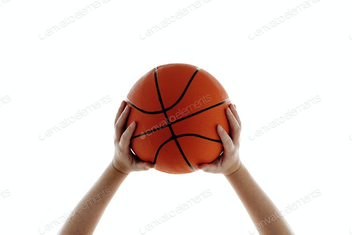 woman holding basketball photo by stevanovicigor on envato elements