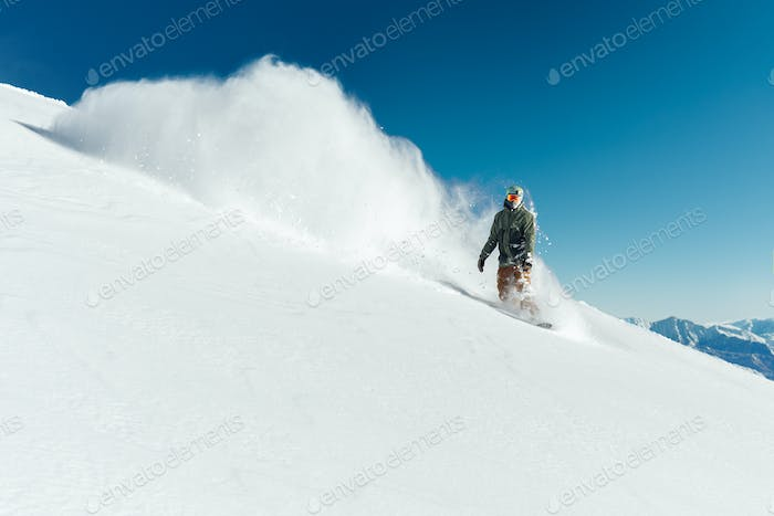 snowboarder in gear brakes on   slope freeride brakes creating a