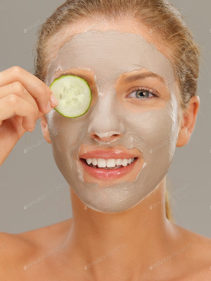 beautiful woman having a facial treatment, smiling
