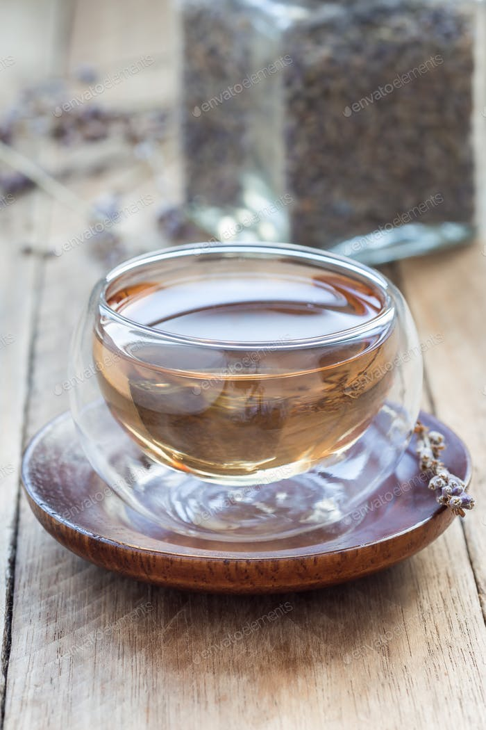 Healthy herbal lavender tea in oriental glass cup, vertical