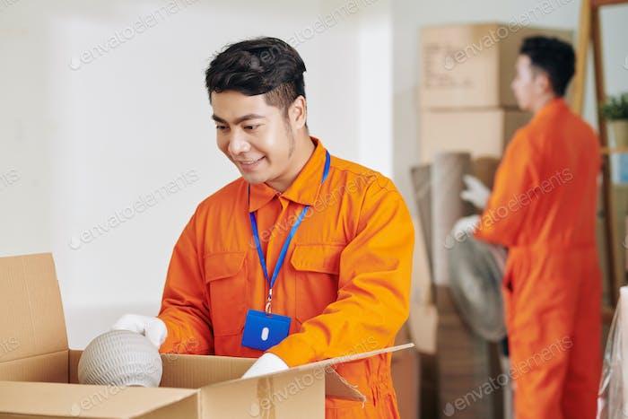Modern Moving Men At Work