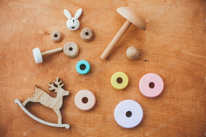 Stylish wooden toys for child on wooden table