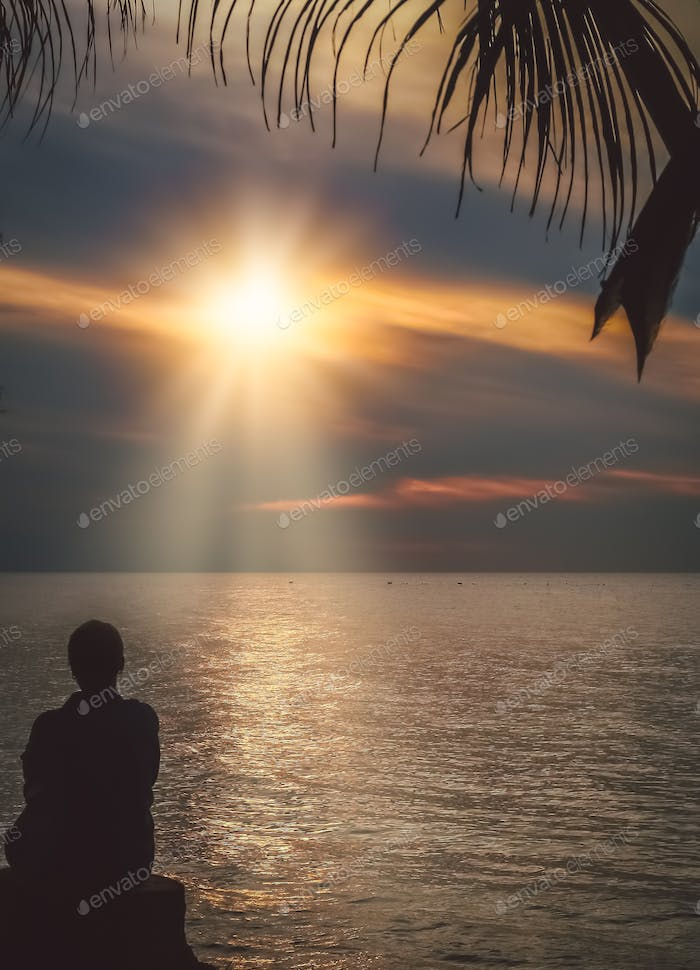 Admiring sunset on the Bali beach