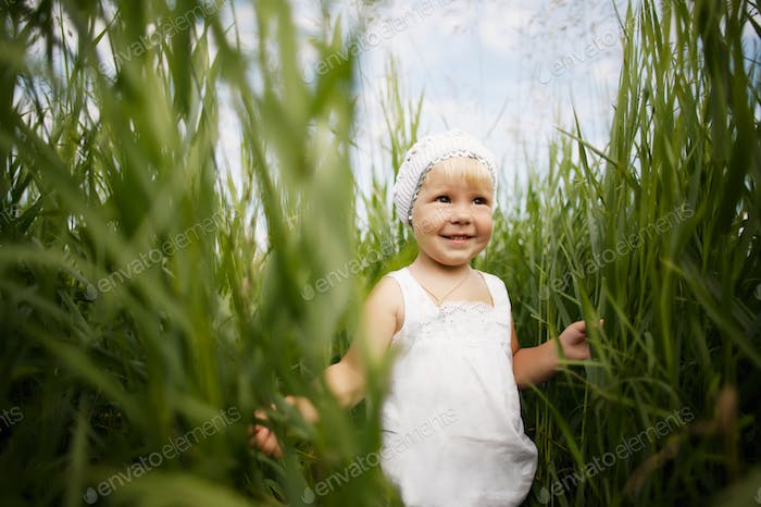 cute little girl in high grass
