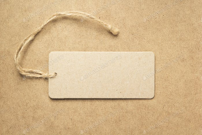 price label at wooden background texture