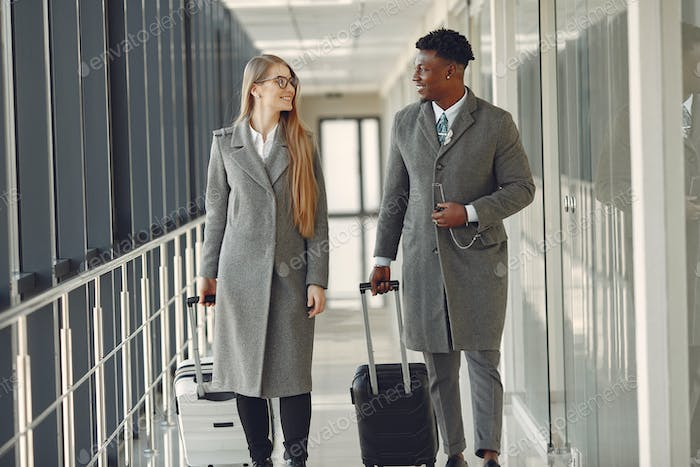 Elegant black man at the airport with his businesspartner