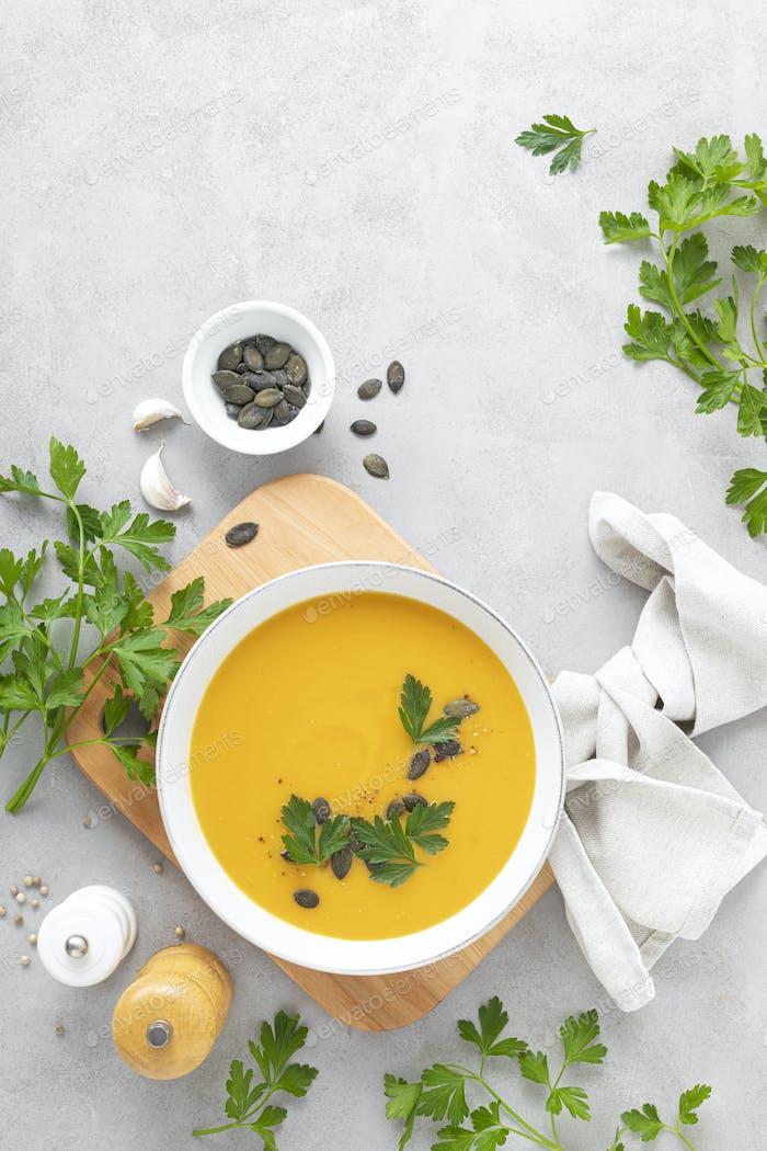 Vegan pumpkin soup with garlic and parsley