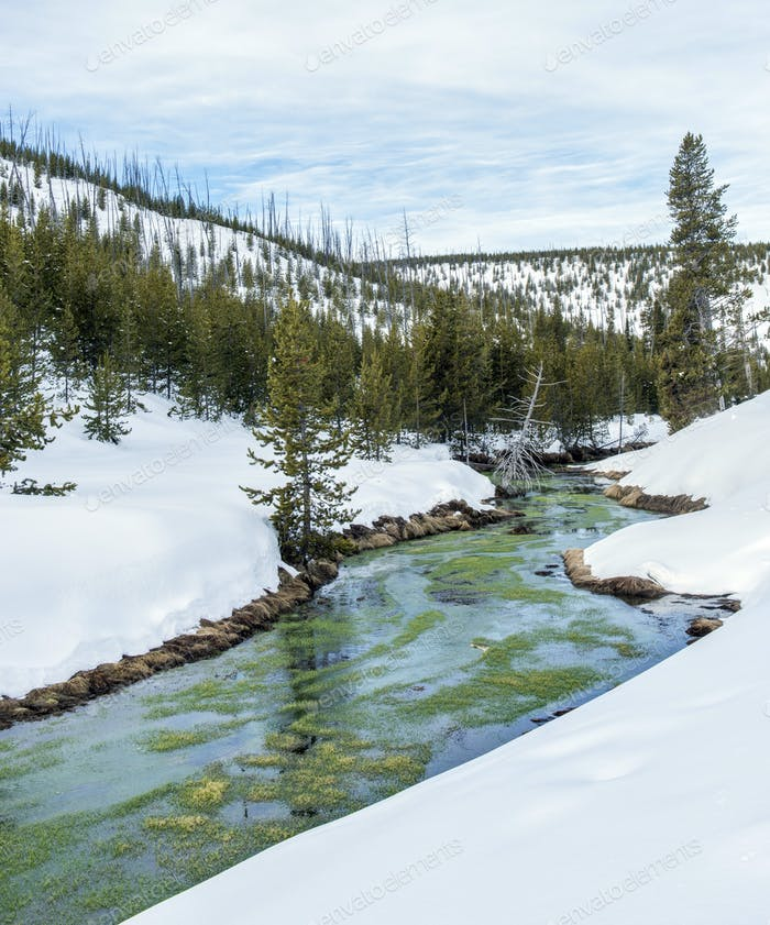 River and snowy hills in remote landscaper
