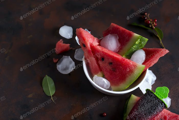 Triangle shaped watermelon slices placed with ice