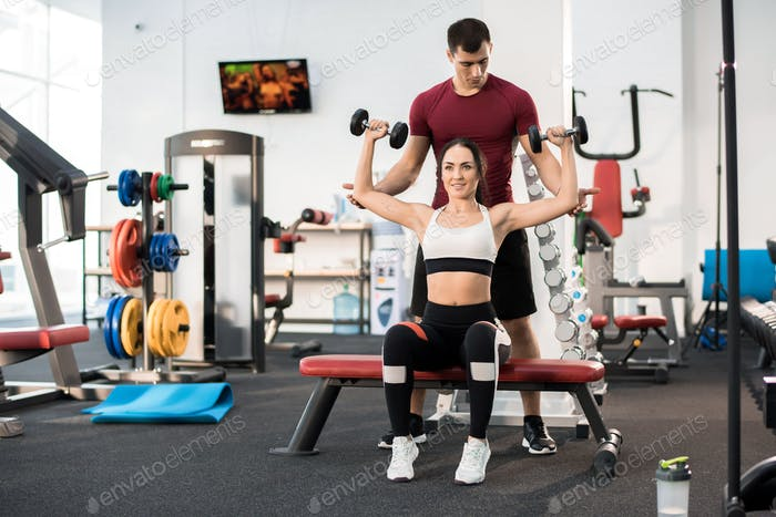 Woman Training with Personal Fitness Coach