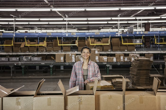 Portrait of an African American female warehouse worker in a large distribution warehouse with