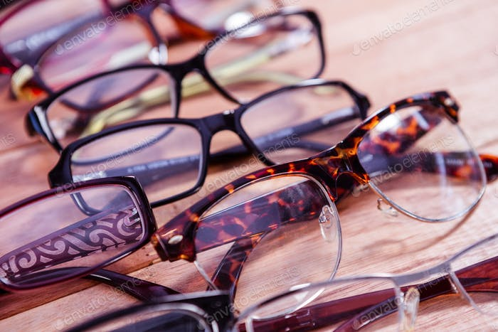View of reading glasses on table