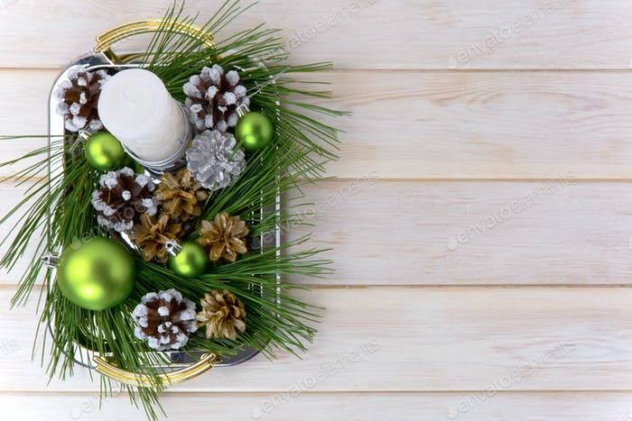 Christmas background with snowy pinecone decorated centerpiece