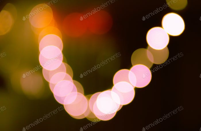 Blurred bokeh lights background in vibrant colors