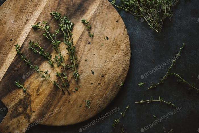 Aerial view of fresh thymes herb on wooden table