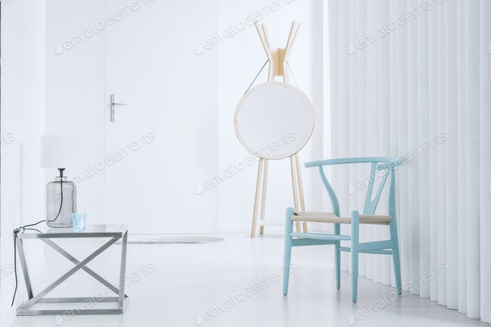 Hall with blue wooden chair