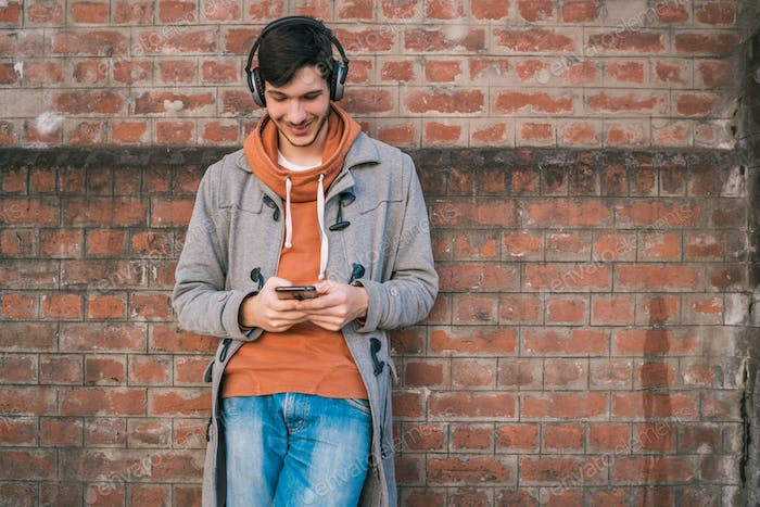 Young man using his mobile phone.