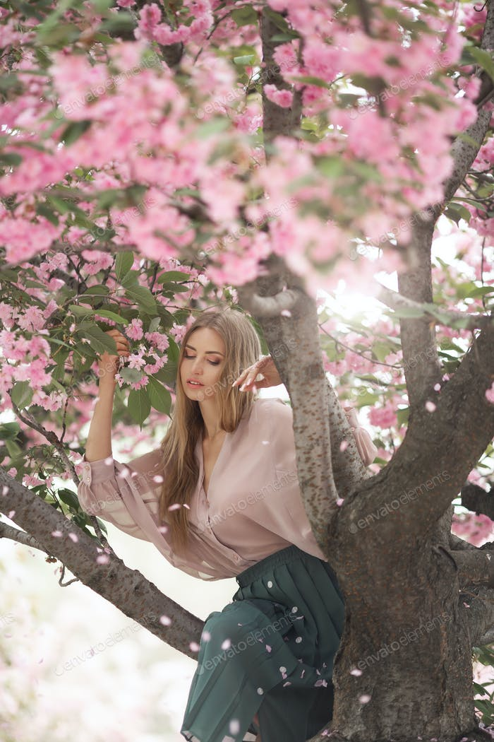 Woman at Blossoming Sakura Tree on Nature