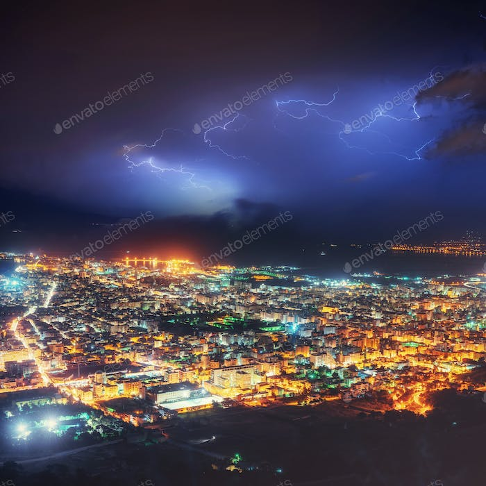 Night lights of the coastal city from the height