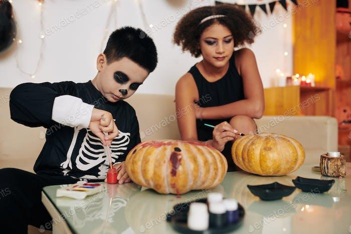Painting carved pumpkins